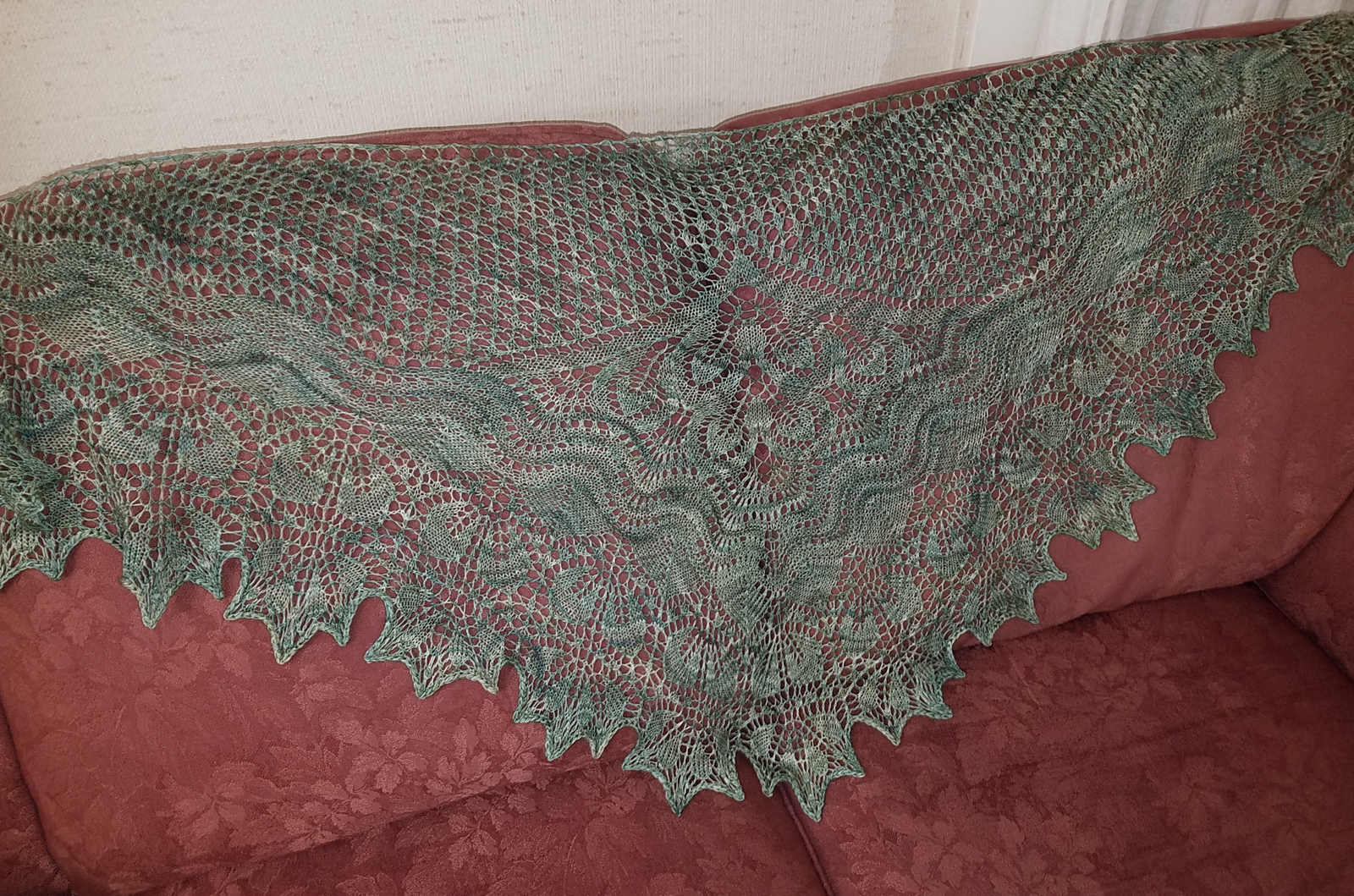 Green laceweight shawl with a leaf pattern